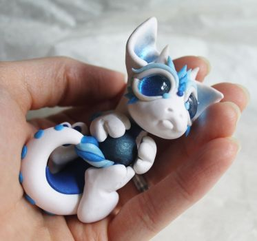 White and Blue Bitty Baby Dragon with a ball by BittyBiteyOnes