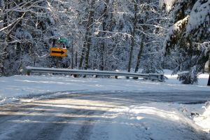 Icy Road with Snow and Sign by happeningstock