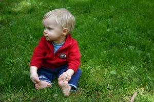 Baby in the Grass 1 by ArtistStock