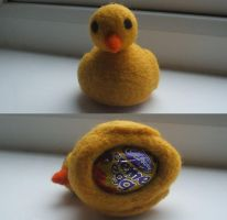 Needle-felted creme egg cover by Scarygothgirl