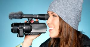 Young adult female points video camera by FozzyNetwork
