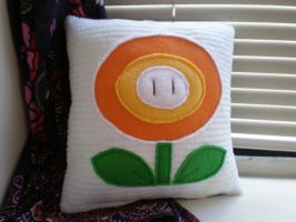Super Mario Fire Flower Pillow by Omonomopoeia