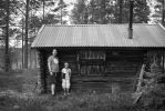 Father and Son in Front of Hunting Cabin by PEN-at-Work