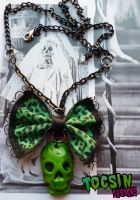 BOW SKULL NECKLACE by TocsinDesigns