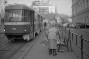 Old Lady Cleaning the Tram Stop by kojotisko