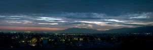 A City and Mountains in Twilight by FellowPhotographer
