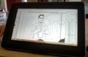 working on my tablet by Needham-Comics