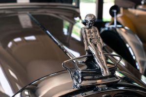 Packard Adonis Sliding Boy Hood Ornament by PLutonius