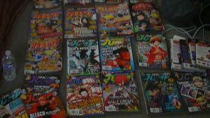 ~MY MANGA COLLECTION SPREAD OUT!!!!!!! XDDDD :D by SuperSayian5Naruto