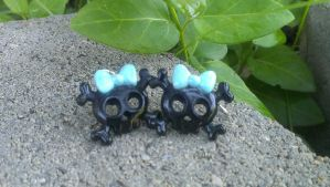 Blue And Black Skull ear rings by Rini-Dragoone