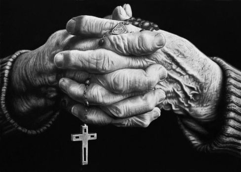Hyper realistic hands of old person holding rosary by woodenpalette