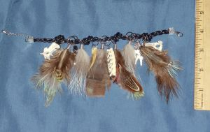 Various Animal Bones, feathers and Stones Bracelet by Magelet