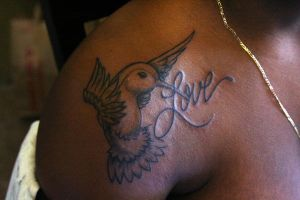 Humming bird tattoo by demmanuel