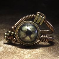 Green eye steampunk ring by CatherinetteRings