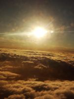 Sunrise Clouds 7 - taken from an airplane- by IoannisCleary