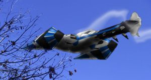 Swordship over a tree by madcomm