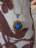Blue and Gold Necklace by LoekazCharms