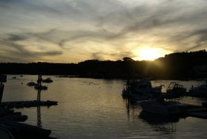 Sunset over a harbor in Maine by rbrew