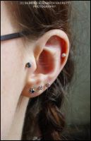 Tragus Piercing by Hitomii