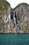 A waterfall into fjord 2 by TFuruhashii