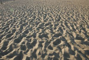 FOOT PRINTS IN THE SAND by planetzog