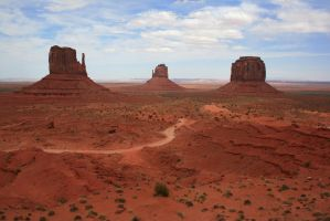 Unpaved road to the buttes by Dr-J-Zoidberg