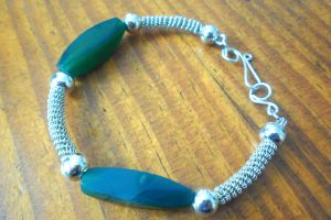 green and silver coil bangle by slinkyskinked