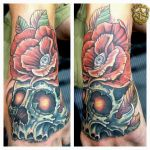 Skull with Rose Hand Tattoo done by Sean Ambrose by seanspoison