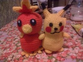 Torchic and Pikachu by Tigrite