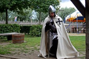Teutonic knight praying 2 by Dewfooter