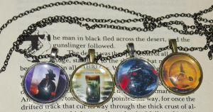 The Dark Tower books 1-4 pendants by ShadyDarkGirl