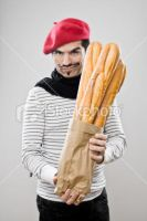 Ist2 8514665-frenchman-with-french-baguettes by DlSASTERS