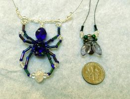 Beaded spider and fly by wombat1138