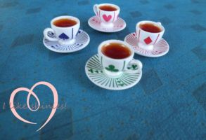 Rement teacup jewellery by ilikeshiniesfakery