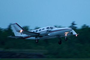 Twin Cessna departing by tdogg115