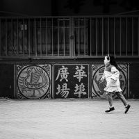 Running in Chinatown Square by jonniedee