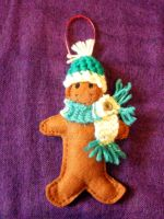 Felt gingerbread decoration with knit accessories by moonwolf17