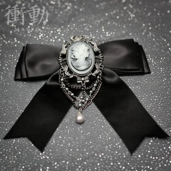Black Bow and Cameo Barrette by shoudoumagic