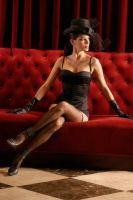 Lucy on a red sofa by albertofoto