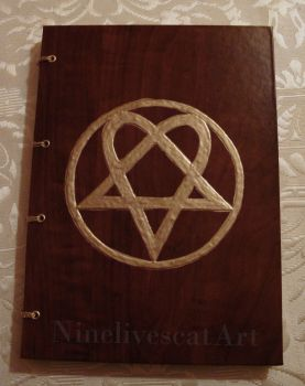 Notebook with heartagram by NinelivescatArt