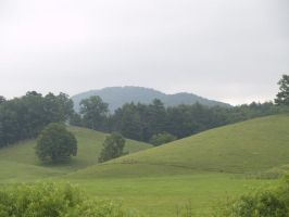 hilly pasture by Irie-Stock
