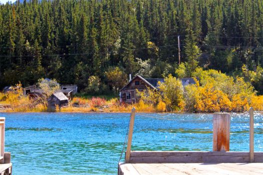 Old dock and house by whitneymusil