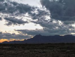 Storm Clouds coming over the mountain by whendt