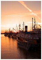 Fishing Boats at Sunset by Val-Faustino