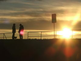 Two people on the dike by Hun-Ter