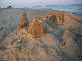 sand castle of faces by willartmaster