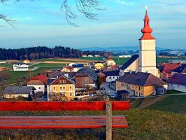 Bench with village scenery by patrickjobst