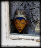 face at the window by awjay
