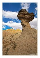 Rock Tower With Badlands by Julian-Bunker