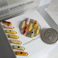 1:12 scale miniature eclairs with giant coin by Snowfern